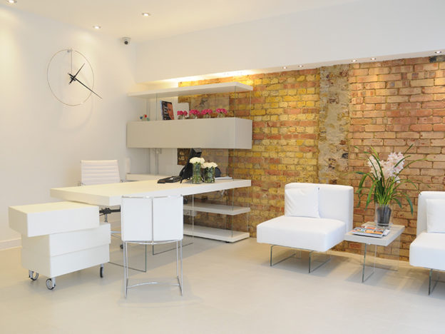 Photo of high end interior designed reception with exposed brick