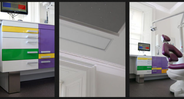 Dental treatment room with contrasting coloured cabinetry