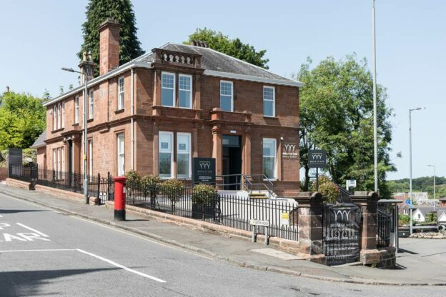 Victorian Red Sandstone Villa with Black signage for Dental Practice