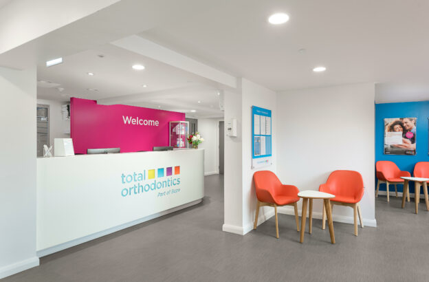 Image of an orthodontics surgery waiting area and reception desk